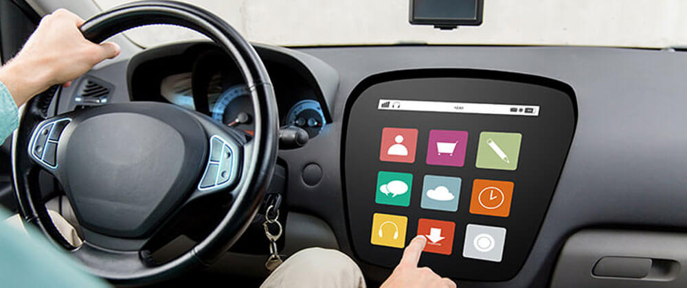 IoT technology being used in a car with a touch screen