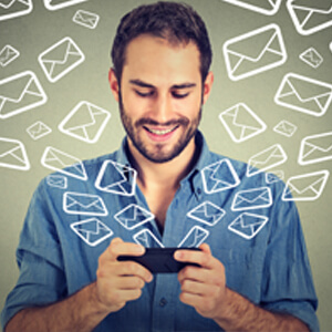 man on mobile phone with email icons