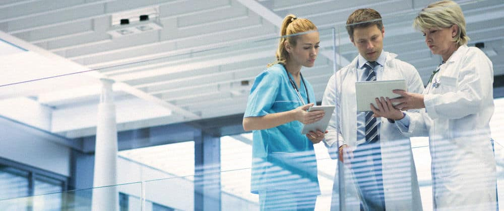 healthcare workers looking at mobile device